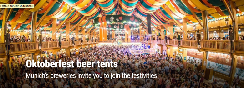 Giant Oktoberfest beer tent with a swarm of people in it