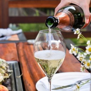 best summer wine - pouring champagne on the Angara grill table