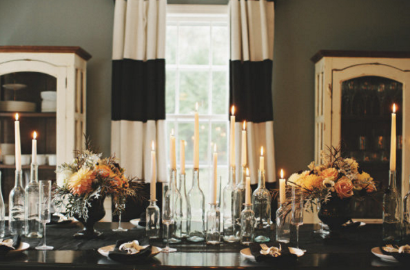 table set with glass bottle candle holders