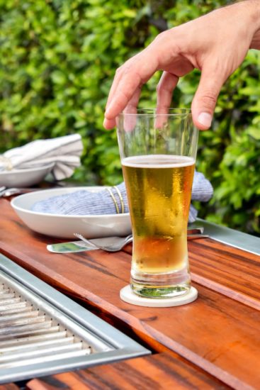Glass of beer on Angara grill table