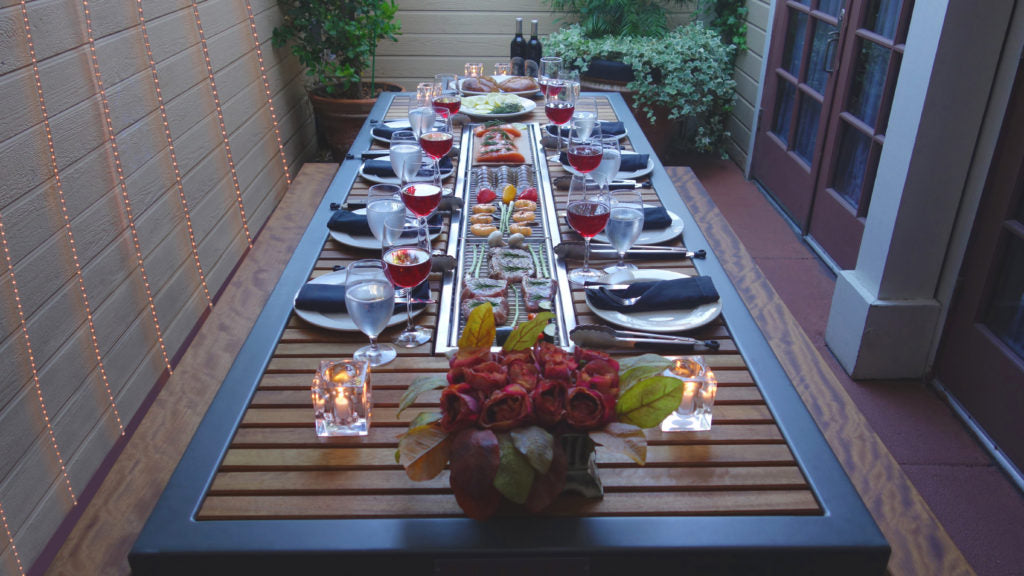 iBBQ Angara grill table set for a dinner party