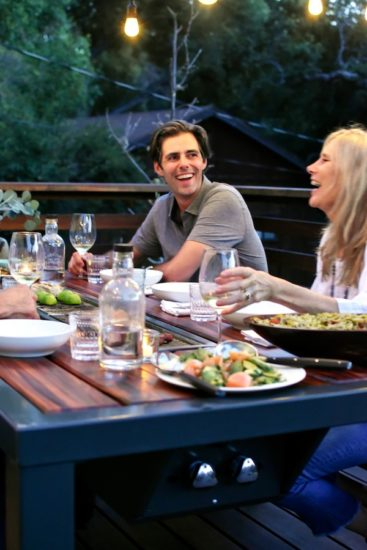 modern outdoor dining table with grill