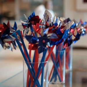 red and blue pinwheels in glass vases
