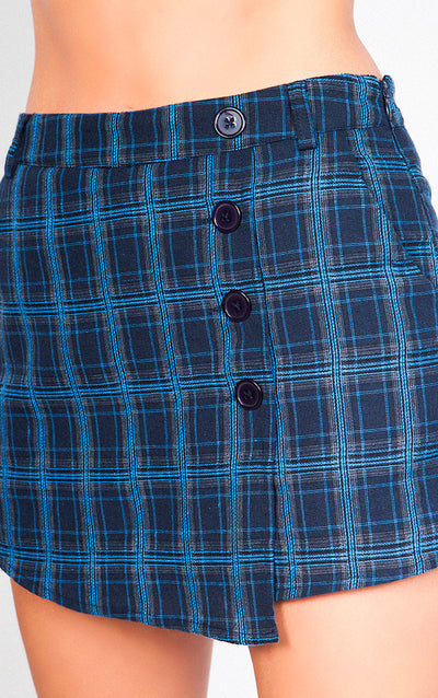 HIGH WAISTED PLAID ASYMMETRICAL SKIRT WITH BUTTON TRIM