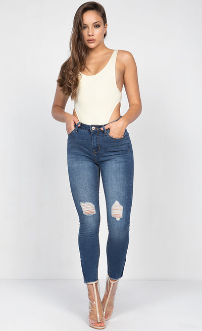 MID RISE DESTRUCTED ANKLE SKINNY JEANS