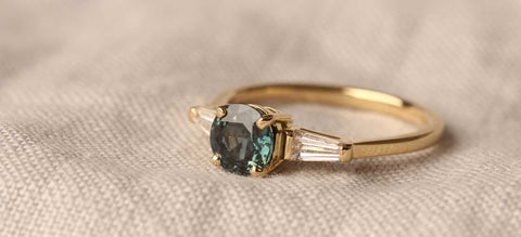 The Jessica engagement ring by EC One handmade in recycled gold with ethical sapphire and conflict free diamonds