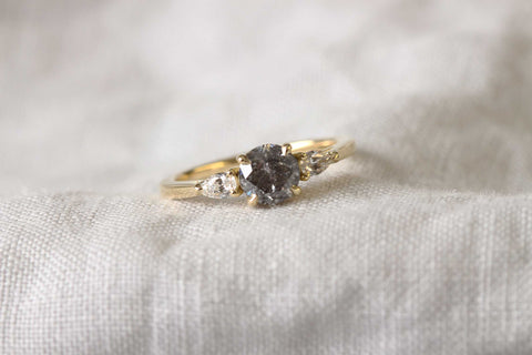 salt and pepper diamond trilogy engagement ring by bespoke jewellers EC One London. Hand made in the EC One London workshop in recycled yellow gold.