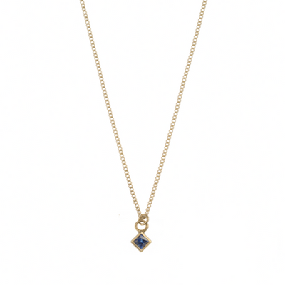 Gold and princess cut blue sapphire necklace by metier at EC One