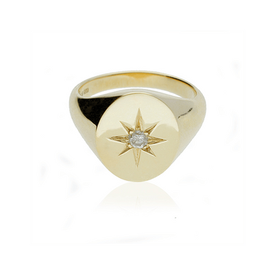 Oval signet ring with star set diamond