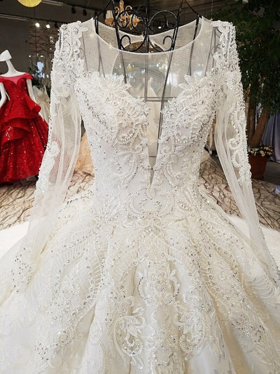 Luxury long sleeves lace up wedding dress with long tail