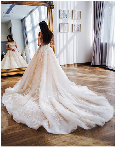 Elegant boat neck embroidered Wedding gown with royal train