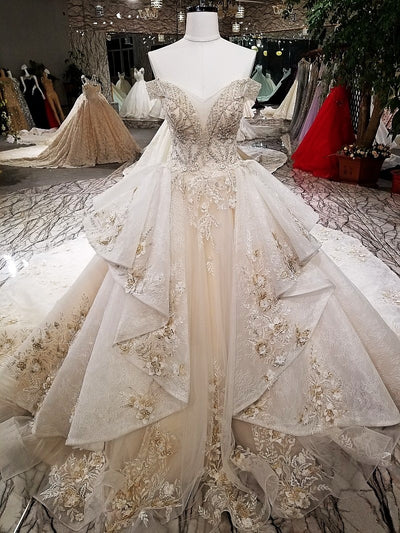 Stunning off the shoulder wedding dress with long train