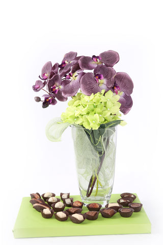 Purple Orchid With Green Hydrangeas In Glass Vase