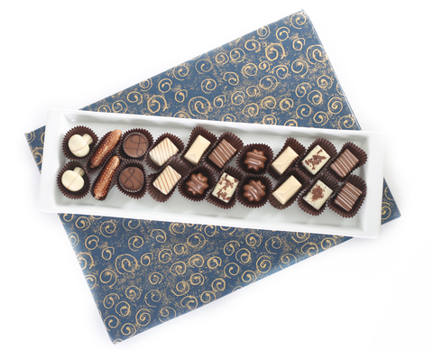 Long white Ceramic tray filled with Chocolates