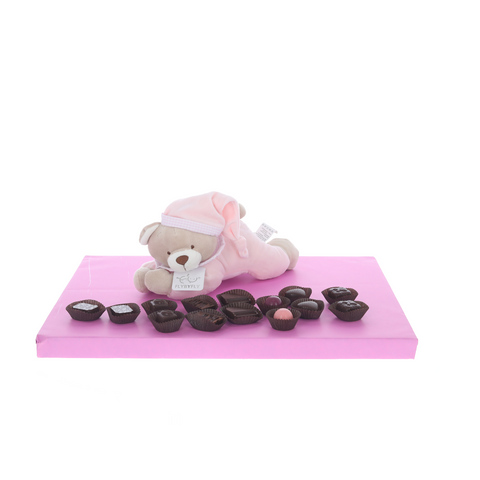 Pink lying teddy with display of Belgian chocolates