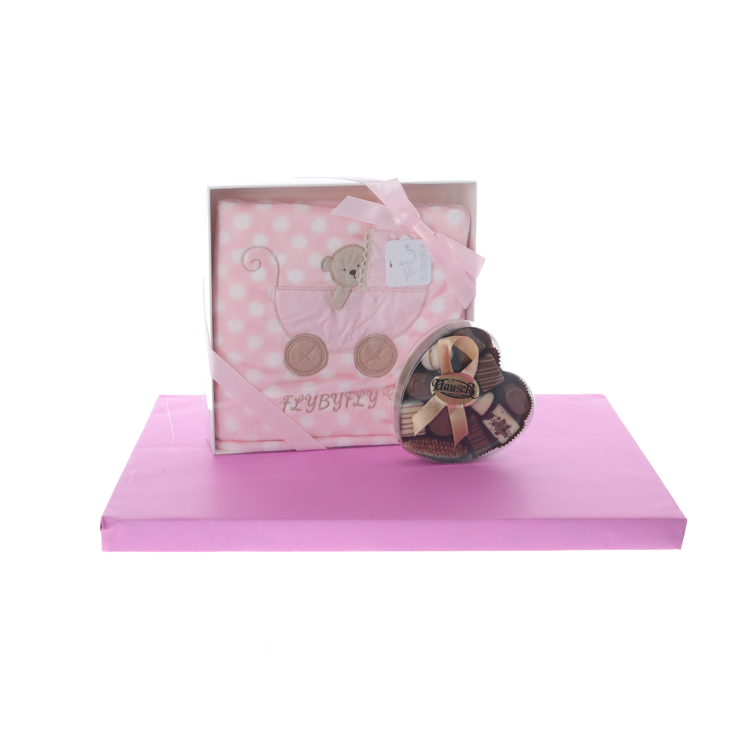 Pink blanket with heart-shaped box of dairy pralines