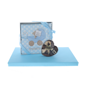 Blue blanket with heart-shaped box of dairy pralines