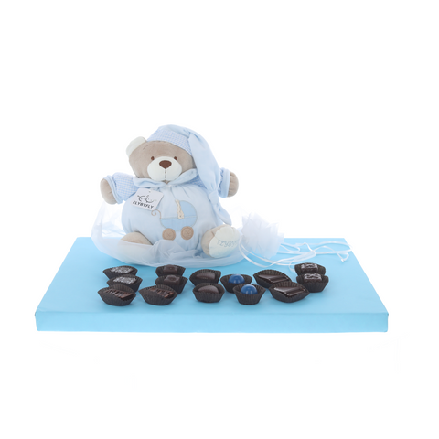 Plush baby toy with music playing pull-string surrounded by delicious Belgian pralines - Boy