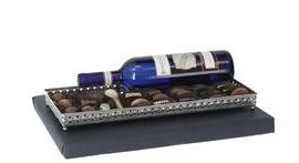 Oblong mirror tray with beautiful metal frame filled with chocolates plus bartenura wine