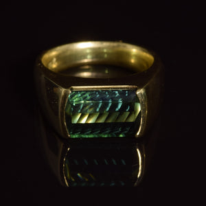 18K green tourmaline fantasy cut baguette ring.
