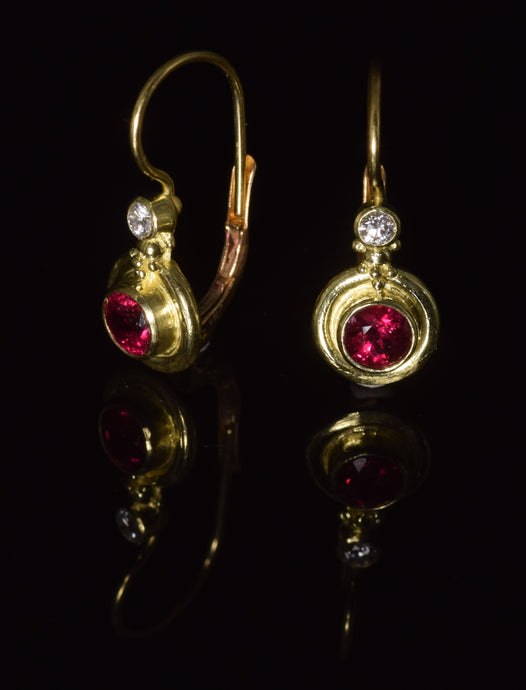 18K yellow gold 4 1/2 mm  faceted ruby French hook earrings with 0,10 ct total weight diamond accent