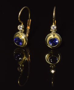 18K yellow gold 4 1/2 mm  faceted sapphire French hook earrings with 0,10 ct total weight diamond accent