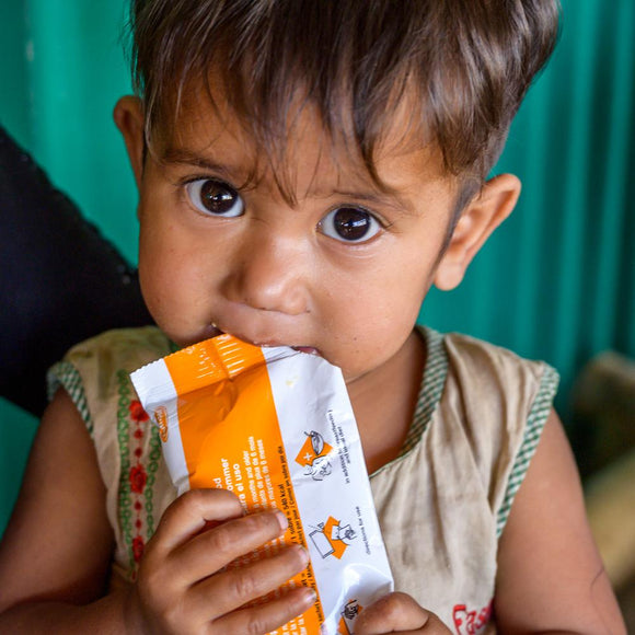 Emergency nutrition packets are given to malnourished children at a mobile health clinic responding to the devastating drought in Afghanistan ©2019 World Vision