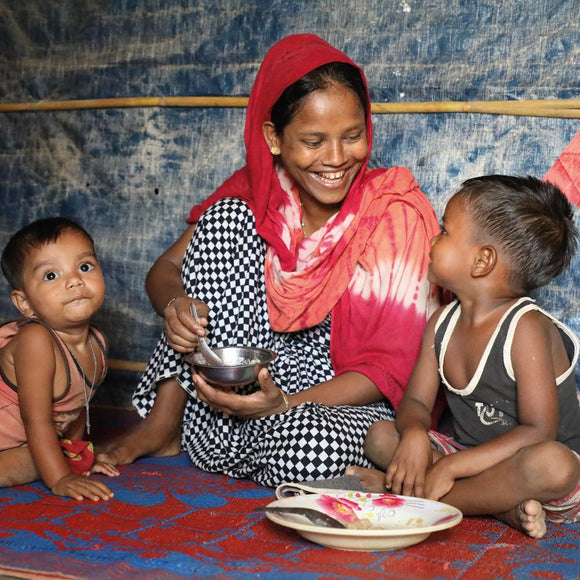 Refugee mother Monira feeds her children, Jisma and Kaiser in Bangladesh ©2019 World Vision