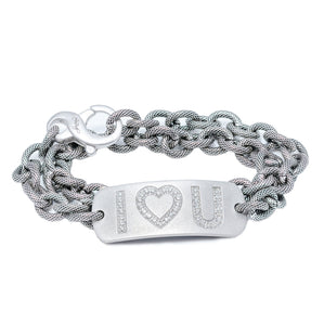 "This bracelet features a satin finish plate with ""I ♡ U"" spelled out in glittering diamonds, double-wrapped on our exclusive textured and oxidized chain.  Available in sterling silver with a light or dark rhodium finish or in 14K yellow gold  Includes a Liza Beth signature satin finish clasp  E/F color single cut diamonds"