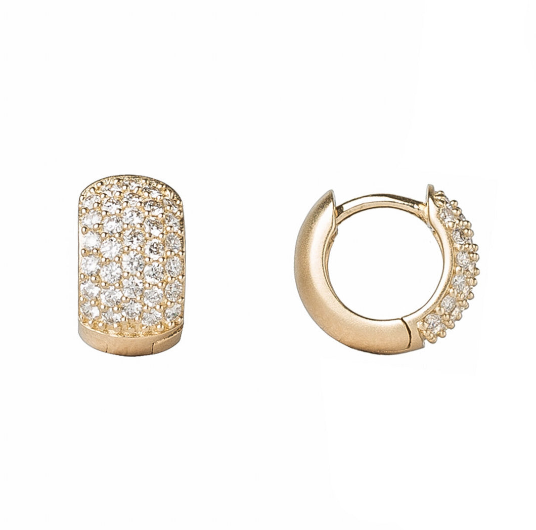 These 14K gold dainty huggies feature five rows of diamond pavé and a hinged enclosure.  Available in 14k yellow or white gold  Satin finish  Hoop diameter is 11mm  Made in USA