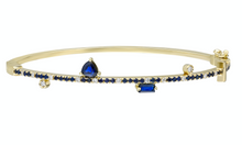 Load image into Gallery viewer, Blue sapphire and 14k yellow gold bangle with double clasp Blue sapphire: .57CT  White diamonds: .16CT  Blue sapphire trillion: .42CT  Blue sapphire baguette: .16CT  Made in Turkey