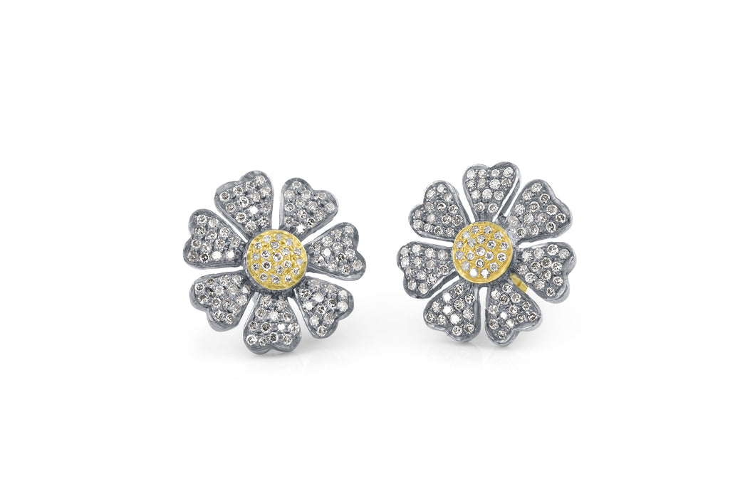Simply sweet, our Daisy studs are covered in diamond pavé.  Available in all sterling silver, sterling silver with 14K yellow gold centers, or sterling silver with 14K rose gold centers  Polished finish  Made in USA
