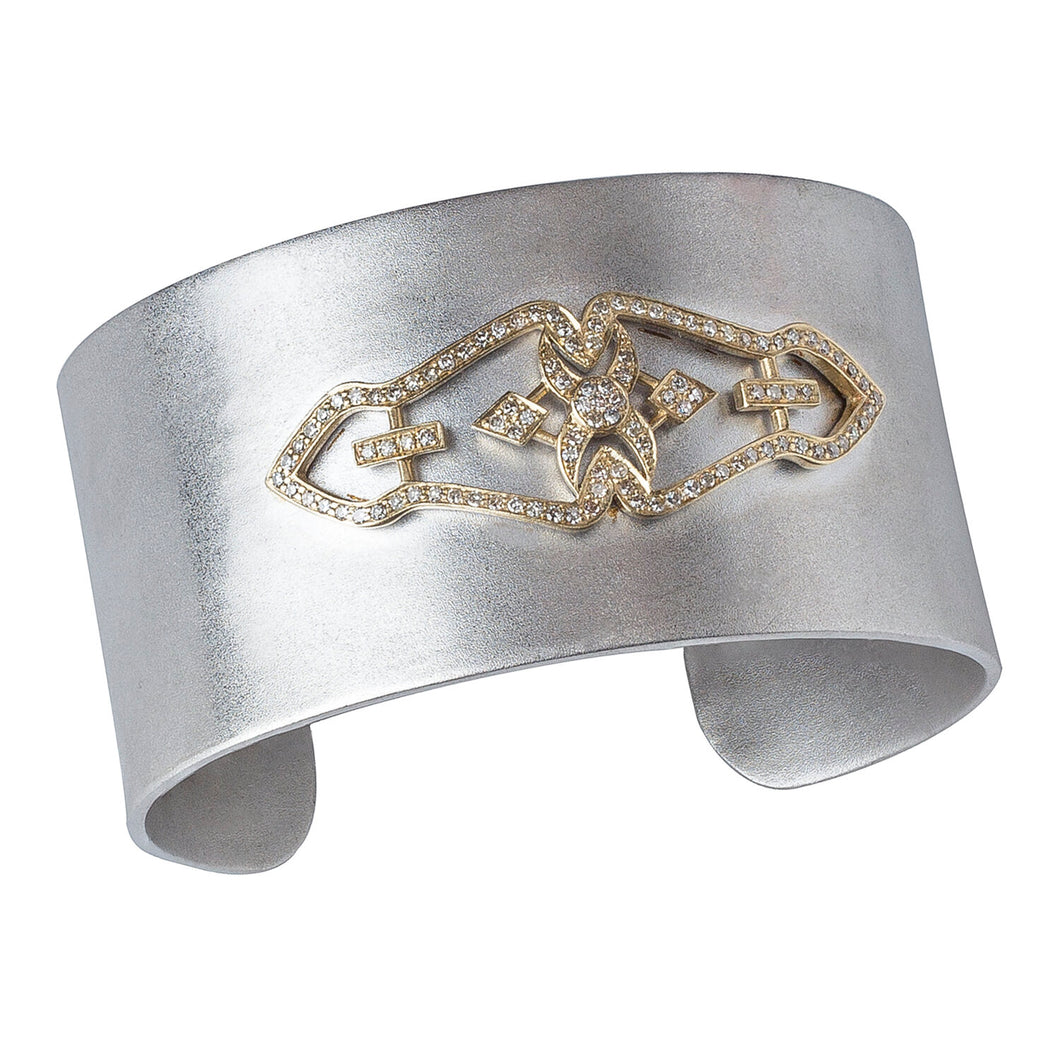 This wide, satin finish, sterling silver cuff bracelet features a vintage shoe clip reproduced in 14 K yellow gold and diamond pavé.  Cuff width: 31 mm  Made in USA