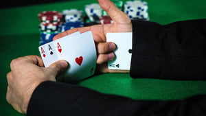 How to Cheat at Poker with a Partner?