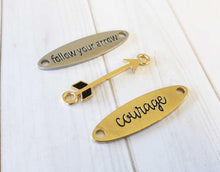 Load image into Gallery viewer, Quote Connectors Quote Pendants Word Pendants Quote Links FOLLOW YOUR ARROW Pendant Courage Charm Antiqued Silver Antiqued Gold Charms Set
