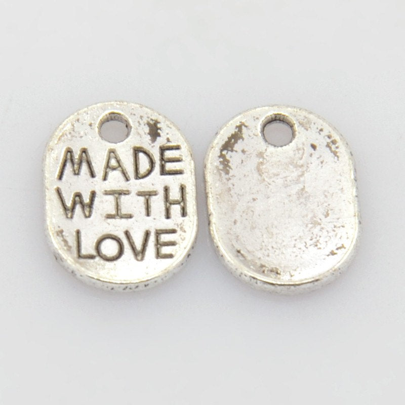 Made With Love Charms Antiqued Silver Charms Oval Jewelry Tags Silver Made with Love Tag Charms 25 pieces WHOLESALE Bulk 11mm