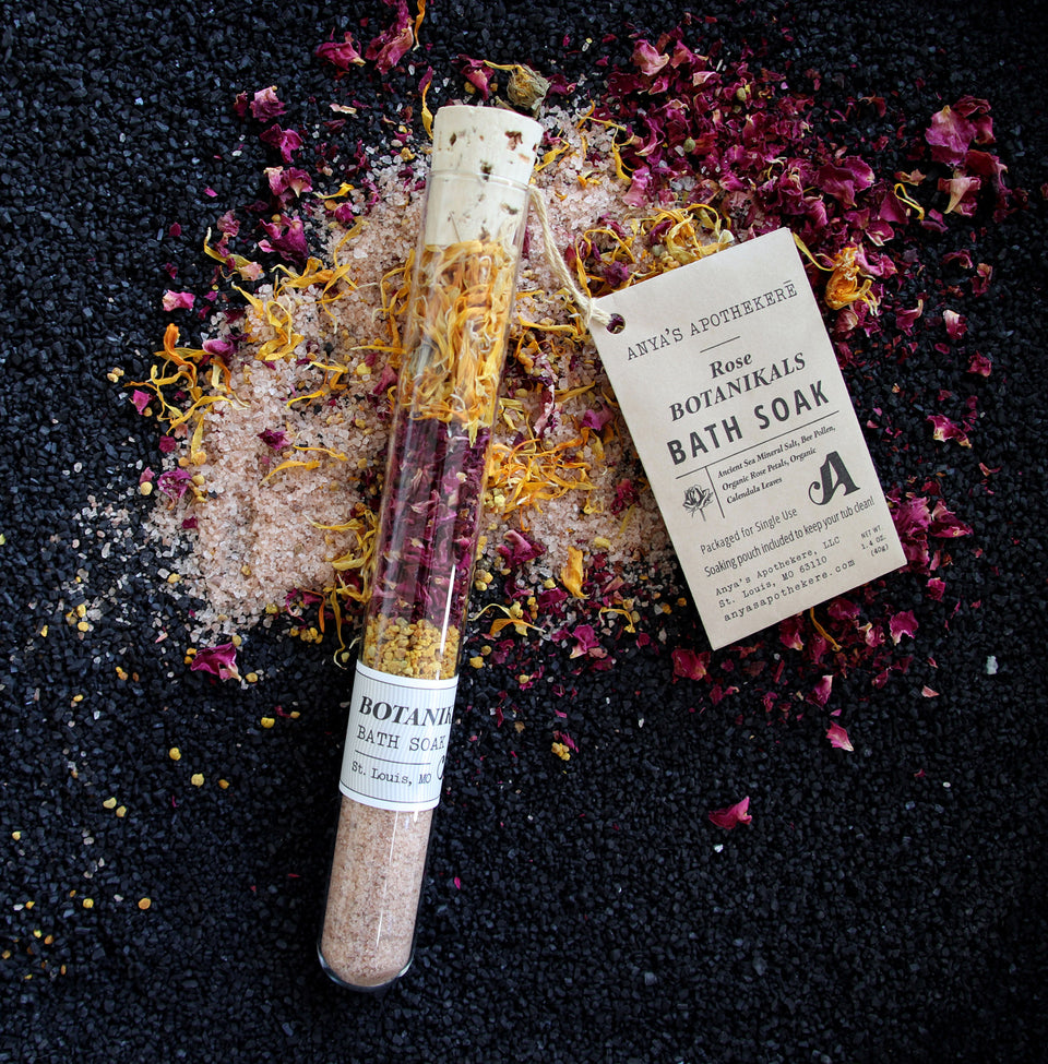Botanikals Bath Soak with layered rose petals, bee pollen, and calendula in beautiful glass tube.
