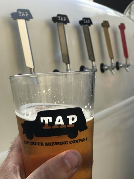 Tap Truck's freshly poured craft beer from it's truckside taps.