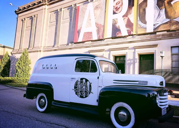 Art district in Buffalo, NY with black and white vintage mobile bar truck