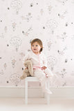 Catch A Star Wallpaper in Pink On Pink featured here with a Toddler. Girls Wallpaper Online.