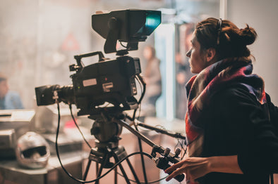 woman operating video camera on a film set