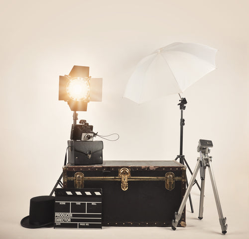 a retro vintage camera with studio lights and photography lighting equipment