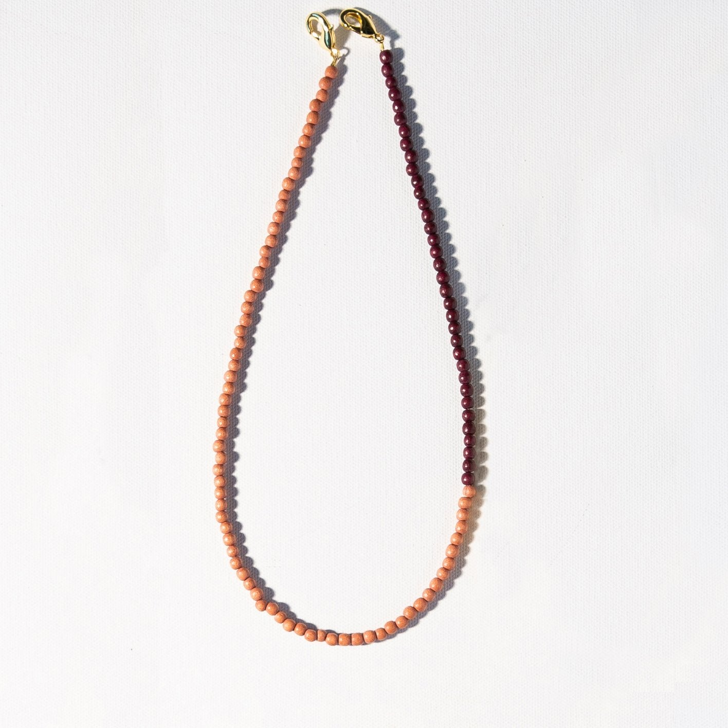Ink + Alloy - Wood Mask Necklace (Blush and Berry)