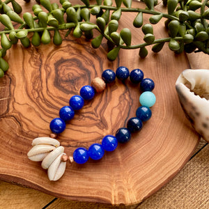 Blue Beaded Stretch Bracelet w/ Cowrie Shell & Copper Accents
