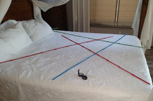 Geopathic stress found on a bed.  Hartmann lines (also called Global Grid lines) and Curry lines.