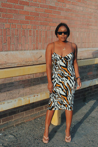 Animal print body-con midi dress with slit on back.