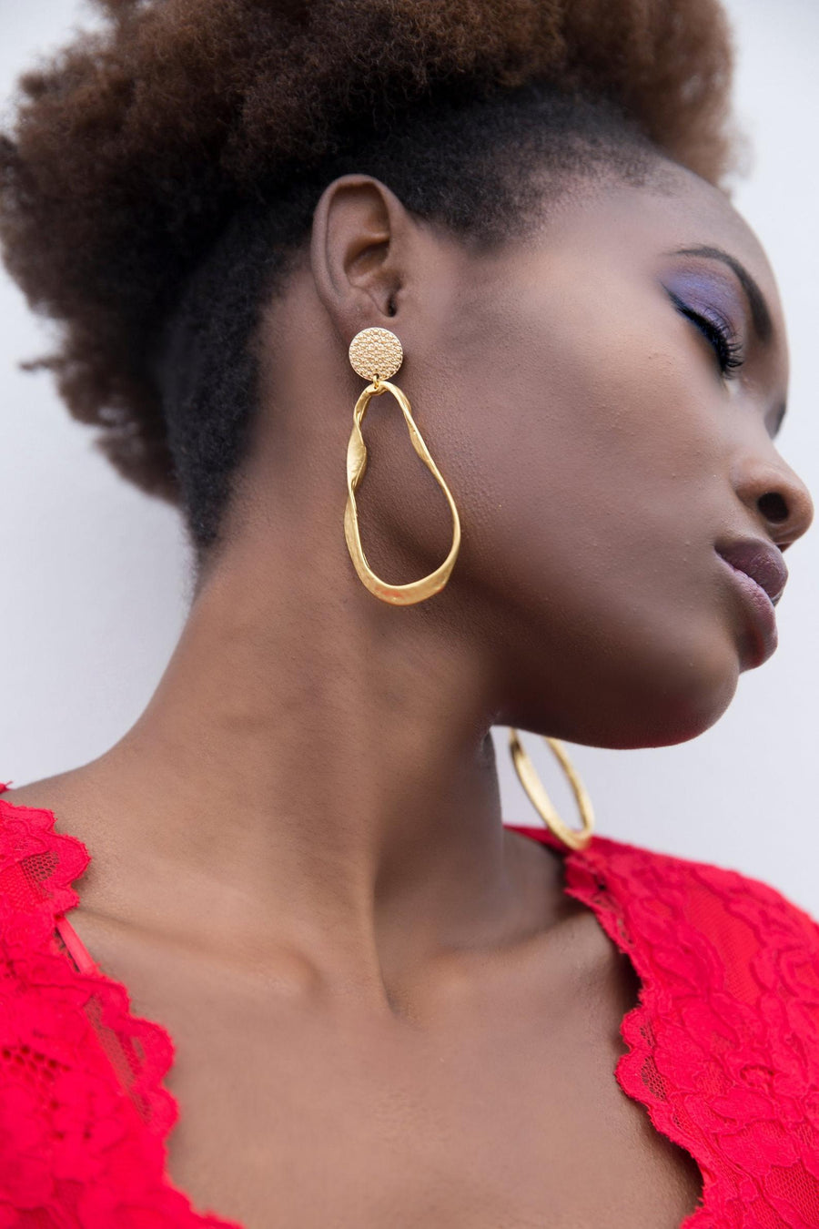 Curvaceous hoop earrings