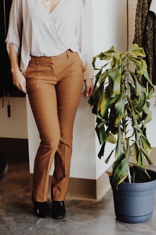 Mustard tapered pants with black booties and grey Lush top