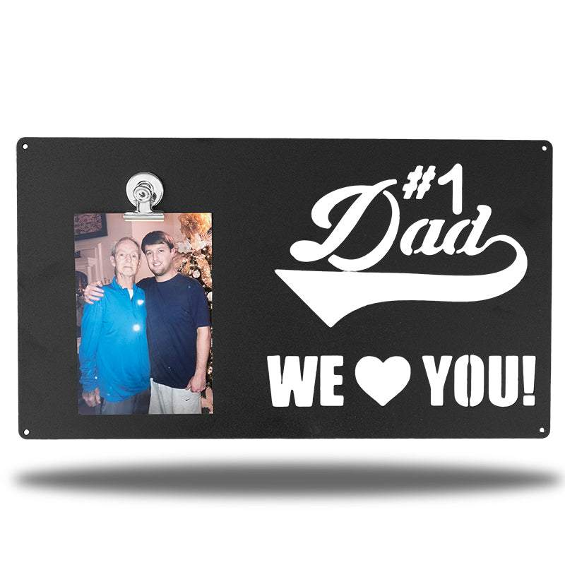 "Black decorative picture board sign with a photo of a man and an older man along with the texts ""#1 Dad We Love You!"""