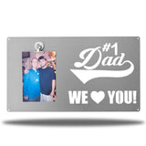 "Silver decorative picture board sign with a photo of a man and an older man along with the texts ""#1 Dad We Love You!"""